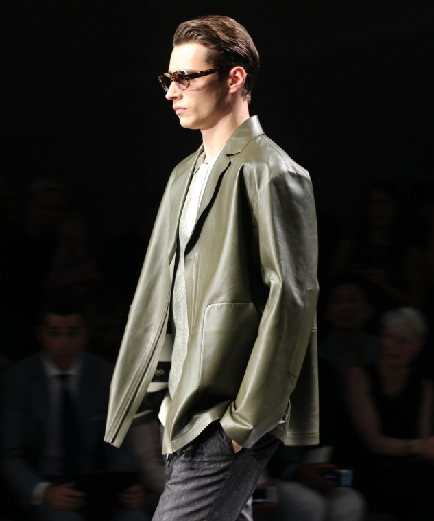Model Adrian Sahores in an olive green leather jacket and matching metallic shirt